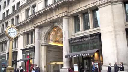 Eataly Caffe and famous 5th Ave clock in slow motion from moving vehicle in Manhattan NYC