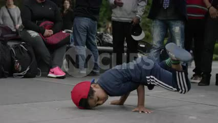 bee boy break dancer kid breakdancing in summer Washington Square Park 4K slow motion