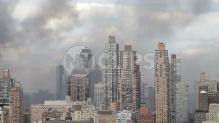 smoke cloud from fire covering buildings in Midtown Manhattan
