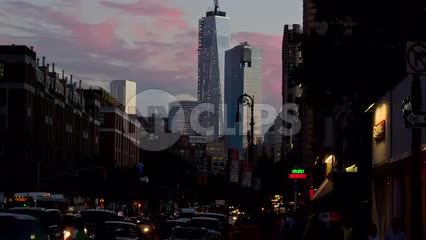 Freedom Tower at dusk early evening 6th Avenue - pink sunset sky Manhattan NYC