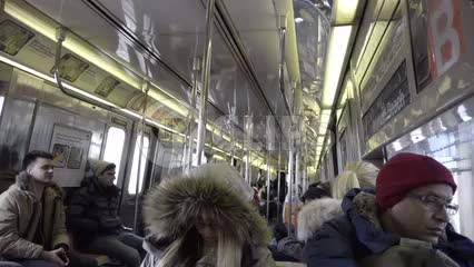 interior subway car - passengers riding B train in winter