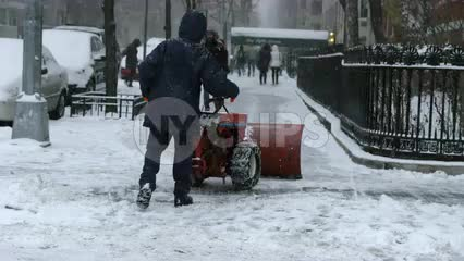 man plowing snow with plow in storm - snowing blizzard in Manhattan winter 4K