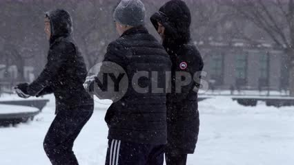 College student throwing snowball in Washington Square Park NYC
