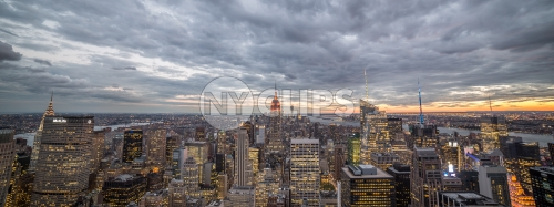 Manhattan at sunset from high view with Empire State Building and city lights in NYC
