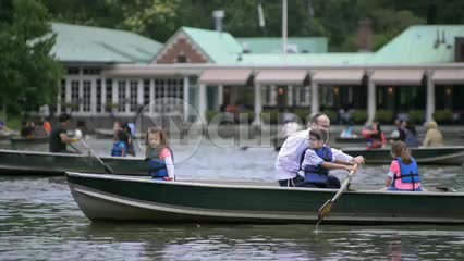 people in row boats in Central Park - Jewish family rowing in lake pond water