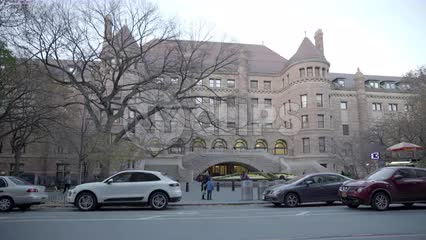 American Museum of Natural History side entrance cars driving by afternoon establishing shot