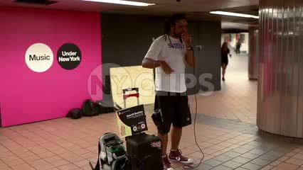 musician beatboxing - beatboxer in subway station in summer - New York City