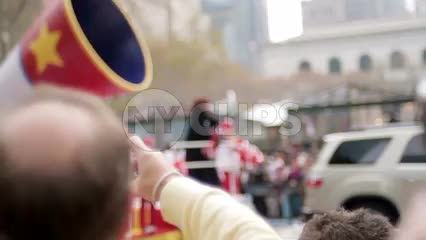Gloria Gaynor on Macy's Thanksgiving Day Parade float with cheerleaders shaking pompoms in Midtown Manhattan NYC