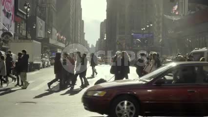 crowded crosswalk - people crossing busy street and cars, taxi cab driving across intersection - winter or fall in Midtown Manhattan New York City NYC 1080 HD