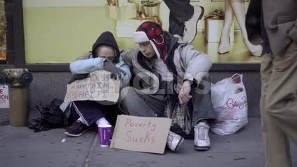 homeless couple struggling with help signs, poverty sucks for street people in New York City NYC