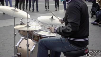 drummer playing music with band musicians - drumming in Washington Square Park on cold fall day - Manhattan New York City NYC