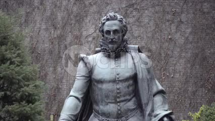 Miguel Cervantes statue at Washington Square and 5th Ave in NYU courtyard garden, down long walkway in NYC 1080