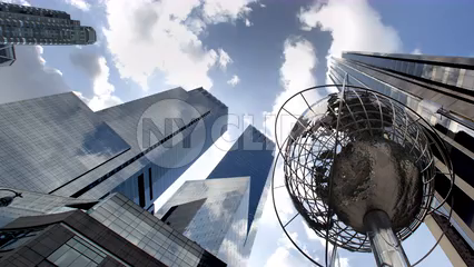 Globe sculpture in Columbus Circle with Time Warner Towers upward angle - day to night timelapse in Manhattan 4K and 1080 HD NYC