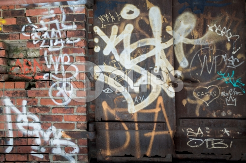 graffiti on gritty brick wall and metal door