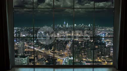 high window view of Manhattan Island from Brooklyn at night timelapse NYC