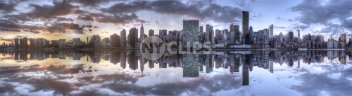 Manhattan skyline Empire State Building, United Nations sunset on East River water with sky and clouds