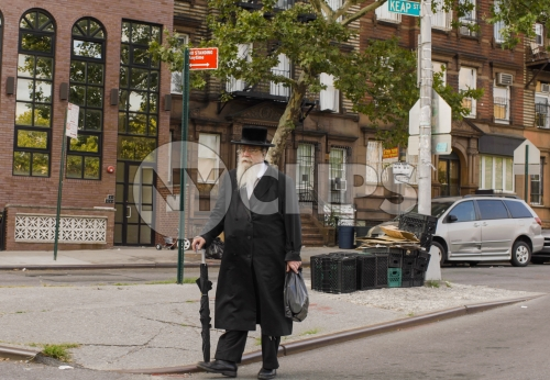 Orthodox Jew taking a walk in Williamsburg Brooklyn New York City