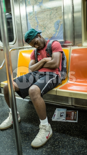 student sleeping on subway train in summer - kid asleep in NYC
