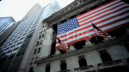New York Stock Exchange - NYSE panning across American flag in Wall Street in Lower Manhattan - Downtown New York City NYC 1080 HD