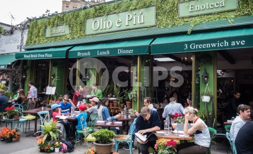 people having Brunch in West Village restaurant on Greenwich Avenue in Manhattan New York City NYC