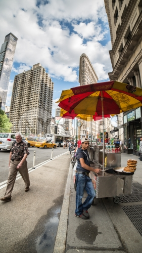 hot dog stand in Flatiron District on 5th Ave - summer day in Manhattan NYC