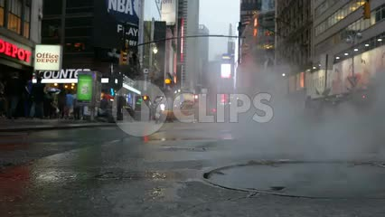 steaming manhole on street with steam coming out in Midtown Manhattan - 34th Street near Times Square