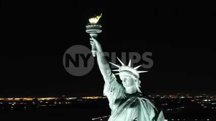 close up of Statue of Liberty aerial circling at night New York City NYC 1080 HD