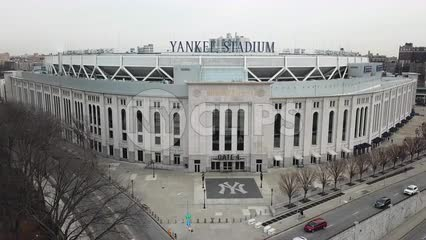 Yankee Stadium aerial fly over - drone flying above front entrance sign in The Bronx New York City NYC in 4K and 1080 HD
