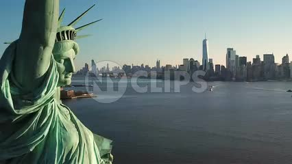 close Statue of Liberty pulling back day time Manhattan skyline New York City NYC 1080 HD