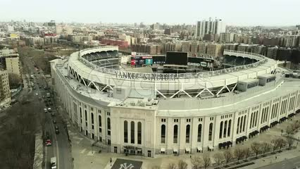Yankee Stadium aerial across front right to left - flying over the Bronx New York City in 4K and 1080 HD