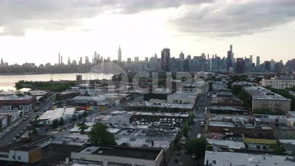aerial over Greenpoint Brooklyn moving toward Manhattan skyline NYC