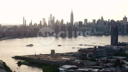 Brooklyn aerial moving toward Manhattan skyline at sunset NYC