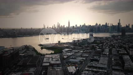 aerial toward Manhattan skyline sunset from Greenpoint Brooklyn New York City NYC