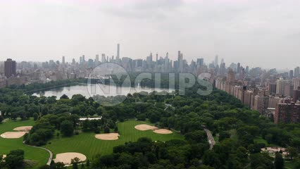 Central Park aerial pulling back over meadow Manhattan New York City NYC