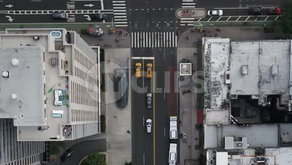 overhead aerial cars driving in Midtown Manhattan traffic NYC