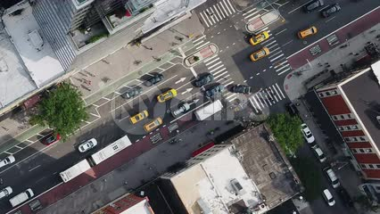 overhead aerial diagonal cars driving in Midtown Manhattan traffic NYC