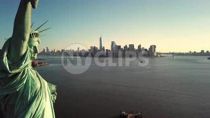 Statue of Liberty aerial pulling back daytime Manhattan skyline New York City NYC 4K and 1080 HD