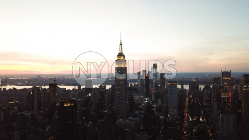 Empire State Building at sunset from high aerial helicopter view in Manhattan New York City NYC