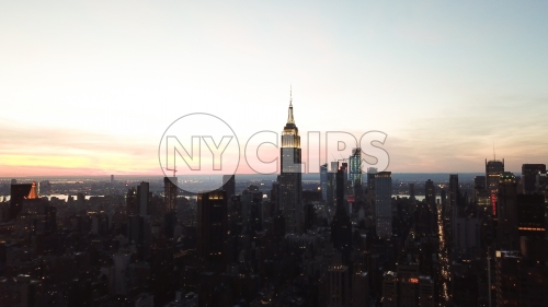 Empire State Building aerial in early evening sunset - Manhattan buildings silhouette in New York City NYC