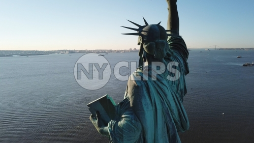 Statue of Liberty rear view looking out onto sea in New York City