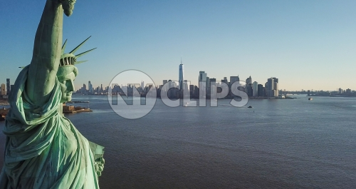 Statue of Liberty closeup with Manhattan skyline in background in New York City NYC