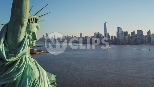 close-up of Statue of Liberty face with Manhattan Island skyline in background in New York City NYC