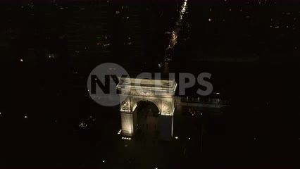 circling arch in Washington Square Park at night in New York City NYC