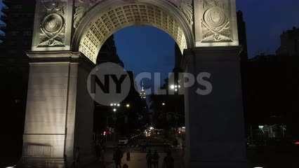 rising shot of Empire State Building from Washington Square Park arch in NYC