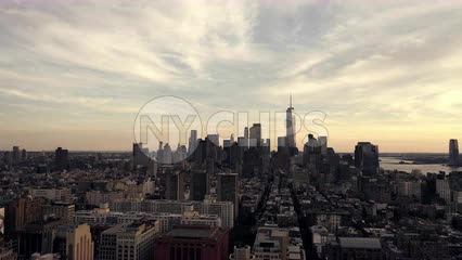 late moving aerial shot pulling backwards from Freedom Tower over Manhattan New York City NYC