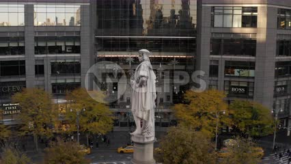 aerial circling Columbus Circle statue in Manhattan New York City NYC