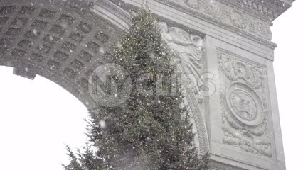 Christmas tree - snowing in Washington Square Park winter holidays NYC