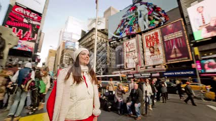 tourist in Times Square on Christmas day in New York City NYC
