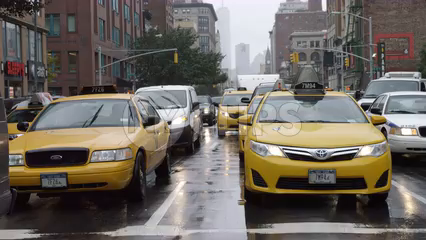 taxi cabs driving in rain with windshield wipers - 4K slow motion on 6th Ave in Manhattan NYC