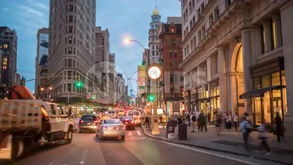5th Avenue clock in evening timelapse - cars speeding in Manhattan traffic - in 4K and 1080 HD in NYC